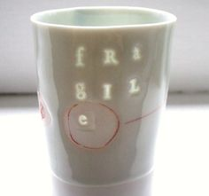 fragile - Translucent porcelain cup. $28.00, via Etsy.