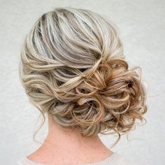 updo wedding bun to the side with curls