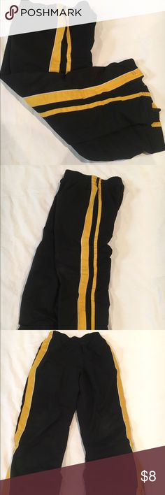 Boys Track Pants- Size Small (6-7) Black Track Pants are fully lined and have pockets. There are zippers at the bottom of each pant leg to widen the opening to get these in or off over shoes. There is a bright yellow/ gold and white stripe down the side. pro spirit Bottoms Sweatpants & Joggers
