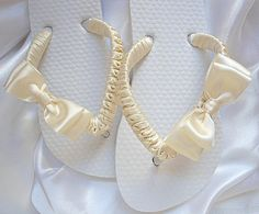 RESERVED FOR JENNIFER  Size 1/2 as shown - rush order  ***********************************************  These precious flower girl flip flops are decorated with ivory satin and a double bow on the side which measures approx. 2.5 across. PROCESSING TIME: 5-7 Business Days until Shipping (another 2-5 business days on domestic shipping).  ✿ MORE DESIGNS: Would you like to see more cute designs? Check out my Flower Girl Flip Flops Section: https://www.etsy.com/shop/Adrian...