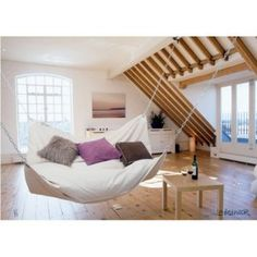 Indoor hammock bed = weightless bliss (or the most expensive hammock ever) $1,499.99 at Hammocks.com