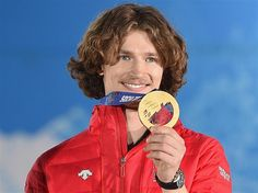 Gold medalist Iouri Podladtchikov of Switzerland celebrates during the medal ceremony for the Snowboard Men's Halfpipe