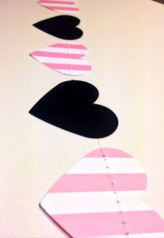 "Price: $11 Description: 10 Feet Long! Victoria Secret Pink & Black Inspired Heart Garland Birthday Party Decor, Bachelorette Parties, Baby Shower Decor, Etc! Hearts are 2.5"" wide. This is made from heavy card stock and the hearts have been machine stitched with transparent thread to give a true floating effect. Each end is finished with …"