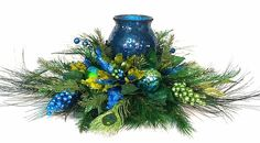 Peacock Poinsettia Centerpiece Christmas Wedding Floral Arrangement w Mosaic Candleholder Turqoise Lime BlinG by Cabin Cove Creations. $165.00, via Etsy.