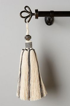 On black metal rod....Tassel Finials #anthropologie