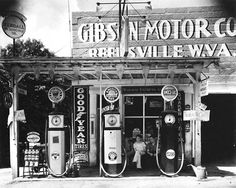 Walker Evans. I remember gas stations like these when I was like 5-6 years old. They phased out quickly after the 1950's.