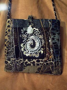 https://flic.kr/p/DBUNW | purse with quartz bead. | 9x9 inches. Stamped with my hand carved stamp with acrylic paint, pieced, quilted and beaded.