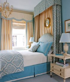 It took 150 yards of luxurious fabric and trim to transform this master bedroom into a space that feels warm and welcoming. As its centerpiece, the spacious room boasts an upholstered headboard tucked into a billowing canopy treatment. The joyful robin's-egg-blue-and-ivory patterned linen -- which is also used in the pleated valance, side curtains, and duvet -- draws attention to the bed and ties its pillows, linens, and bed skirt together.
