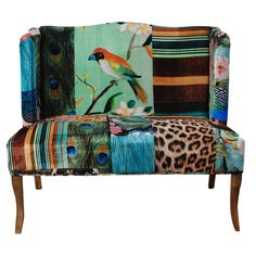 Bring eclectic appeal to your living room with this patchwork-inspired settee, showcasing wood legs and cotton upholstery.