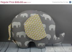 One large (9x12) elephant, made {with love} filled with eco-friendly fiberfill (50% rayon fiber made from bamboo and 50% premium polyester