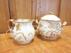 Beautiful white and gold sugar and creamer. From Vendor 317. Priced at $35.00.  This vendor is offering a 20% discount for purchases over $200.00. Call or visit the Brass to find out more. 303-403-1677. ~ The Brass Armadillo Antique Mall in Denver, CO ~