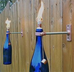 You'll need some hardware (and oil and the proper flame) to pull this one off, but a tiki torch made from wine bottles is a fun way to light up your outdoor space. If all else fails, placing the right-size candle in the bottle neck will get the job done, too.  Source: Etsy User GreatBottlesofFire