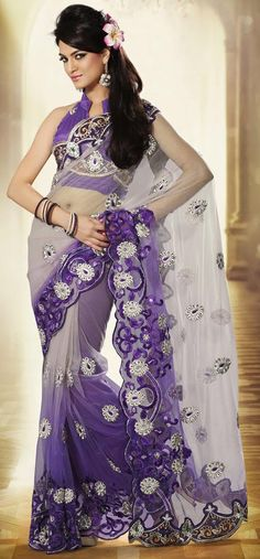 Light gray and purple net saree beautiful with resham, stone, sequins and patch border work. As shown matching blouse can be made available and also can be customized as per your style or pattern subject to fabric limitation.