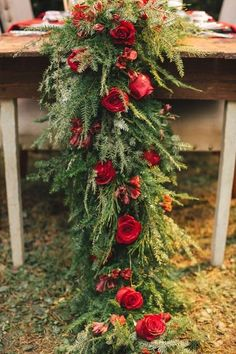 Red Wedding Table Runner: Instead of overloading on the linen rentals, opt instead for a floral table runner. This evergreen garland studded with red roses makes us gasp with delight. Wedding Table Garland, Winter Wedding Decorations, Winter Wedding Flowers, Red Wedding, Wedding Themes, Floral Wedding, Wedding Ideas, Wedding Season, Winter Weddings