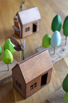 These tiny wooden house vases are so sweet - Radiance