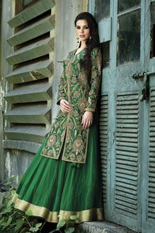 Net ghagra with dupion silk long jacket embellished with zardosi and stone work.