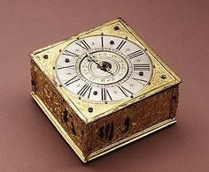 Clock, Table  Date: late 16th century Culture: German Medium: Brass gold-plated, copper silver grained