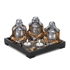 Invite peace and serenity into your home and remind everyone to speak no evil, hear no evil, and see no evil. The wooden frame of this serenity garden is filled with polished stones, two clear glass candle cups, and three charming Buddha statues. Candle Cups, Glass Candle, Clear Glass, Amber Glass, Serenity Garden, Buddha Garden, Garden Candles, See No Evil, Scented Candles