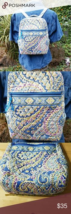 Vera Bradley small backpack Vera Bradley small backpack. Interior has 2 slip pockets exterior has 1 big zip pocket on one side and a small zip pocket on the other. 2 side pockets great for keys or phone. Measurements are approximate and shown in pics. Vera Bradley Bags Backpacks