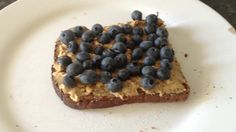 Peanut butter and blueberries on toasted soya and linseed bread. Love this as a pre workout meal