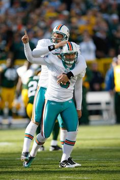"NFL: Miami Dolphins kicker Dan Carpenter and punter Brandon Fields received the Nat Moore Community Service Award yesterday as part of ""FinsWeekend,"" the team's annual fundraising event.  keepinitrealsports.tumblr.com  keepinitrealsports.wordpress.com"