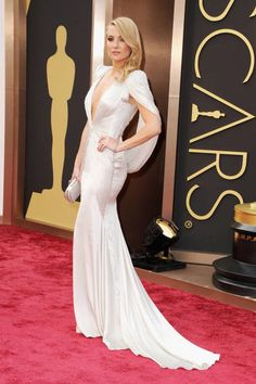 Kate Hudson shows off her assets in a figure-hugging gown on the red carpet.