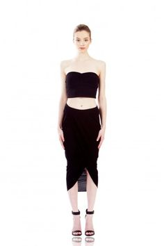 NEW ARRIVALS: Logan Wrap Skirt in Black by KALI. Curve-hugging skirt with a draped back and peekaboo wrap opening make both an entrance and exit. Of-the-moment midi length has a sexy, flattering leg line with vintage appeal, and adjustable waist tabs for a perfect fit. #Fashion #Icelandic #Lastashop #Style