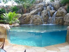 Backyard Pool With Waterfall,Water Features,Glass Infinity Edge & Tropical Landscaping