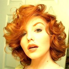 love the hair and color...almost makes me want to cut my hair again!