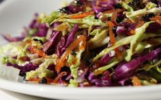 Asian Vegetable Slaw Recipe / Jean-Georges Vongerichten / 1/4 cup mayonnaise 1 Tsp mirin, 1 Tsp rice vinegar, 1/2 Tsp soy sauce, 1/2Tsp fresh lemon juice, 1 small jalapeño, seeded and minced, 1 cup finely shredded red cabbage, 1 cup finely shredded napa cabbage, 1 cup julienned carrot, 1 cup julienned jicama, 1 cup julienned daikon, 1/2 small seedless cucumber, peeled and sliced paper-thin; 2 scallions, thinly sliced; 1 cup mung bean sprouts; Salt