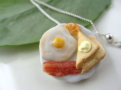 Cute Deluxe Breakfast Necklace  -Bacon Eggs butter and Toast-  Miniature Food Polymer Clay Jewelry Cute Kawaii Deco Ceramic knife. $18.00, via Etsy.