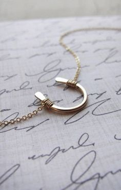 horseshoe necklace.