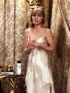 Michelle Pfeiffer as Elvira Hancock Scarface (1983): Elvira may have been tragic, but her glam disco goddess style was anything but.