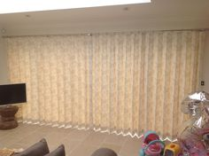 4.5 metre bi-fold doors with inverted pleat curtains in Clarke & Clarke Clarisse Fabric