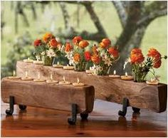 rustic t light holder ...for the holidays you could replace the flowers with holly, pine or other greenery