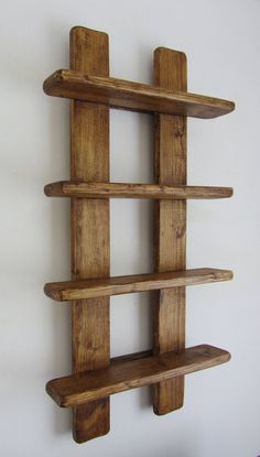 Rustic reclaimed wood 4 tier floating display shelves Handmade from recycled timber Finished in antique brown beeswax Dimensions approx 75 cm tall x 38 cm wide the depth of the shelves is 9 , the distance between shelves is 14 These ar - # Wooden Pallet Shelves, Rustic Shelves, Wooden Pallets, Wood Shelves, Display Shelves, Floating Shelves, Pallet Benches, Pallet Cabinet, Pallet Couch