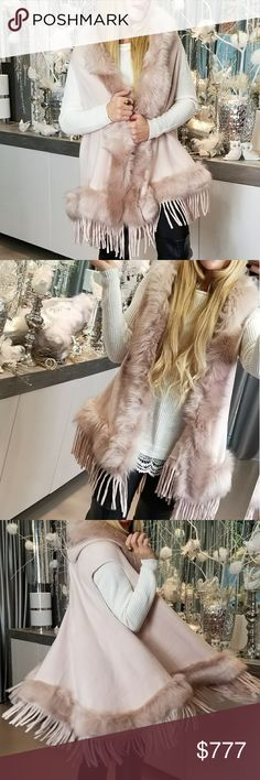 BLUSH PINK FAUX FUR DETAILED VEST Brand new Boutique item Price is firm  Ok if you want a statement piece for the season or upcoming holidays this piece is a MUST!! Featured in a chic blush pink with stunning faux fur & playful fringe detailing this hooded semi-cape vest is a masterpiece! Fabulous quality!       **Christmas winter fall holiday thanksgiving new years gift present poncho cape wrap coat jacket sweater cardigan . Sweaters Shrugs & Ponchos