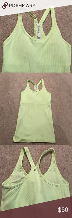 Lululemon tank This is a neon yellow in person! Brighter than the pictures! Has a built in bra (with light padding, I go braless and I'm a 32C) and fits tight throughout. Logo is on the back. Great ribbed material. I have this in multiple colors and love it! lululemon athletica Tops Tank Tops