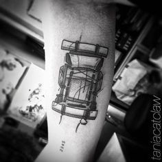 Backpack tattoo on the right inner arm.