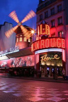 Paris, France - Moulin Rouge by Gilb7, via Flickr**. Probably won't be able to afford a show but still have to go and see it at night.