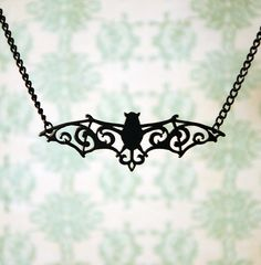 Filigree Neo Victorian Bat ~ Gothic Vampire Black Stainless Steel Necklace by Fable and Fury priced at $34.95. The Victorian style of the bat is what makes this appealing to me.