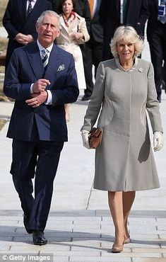 Camilla mixed a classic grey cut with simple heels and cream gloves when she and her husband made a visit to Washington DC last month