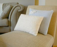 Cushion.  love the simplicity.  White cushion.  Small embellishment on corner which sits off cushion
