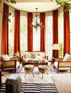 a lovely seating area - love the drama of the long red curtains and the neutrality of everything else!