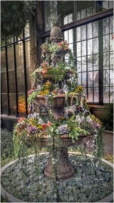 ❤️ WOW! Beautiful tiered water fountain succulent garden! This is the most amazing succulent garden that I have ever seen! Among the succulents are small strings of mini lights that cascade over the sides & down onto the ground so that it looks fabulous even at night! Christmas 2015 at Longwood Gardens (1001 Longwood Rd, Kennett Square, PA 19348).