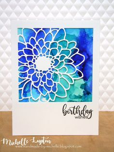 "I have a card using some new products (well, new to me!), with my favourite colours. I used the new ""Mum Flower Frame"" die from Simon Says Stamp, placed over an alcohol ink background using Ranger Adi"