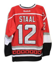 61b093730 Eric Staal Carolina Hurricanes Autographed Red Reebok Jersey