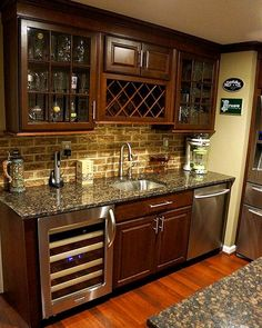 Pk: like the fridge below and wine storage above. Photos: Home Bars and Wine Cellars