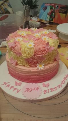 70th birthday cake. Pink buttercream ombre & rose swirls, with butterflies & daisies.