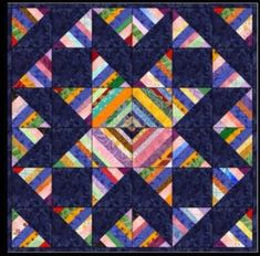 The star in blue captures your focus in this cool layout of a string scrap quilt ~